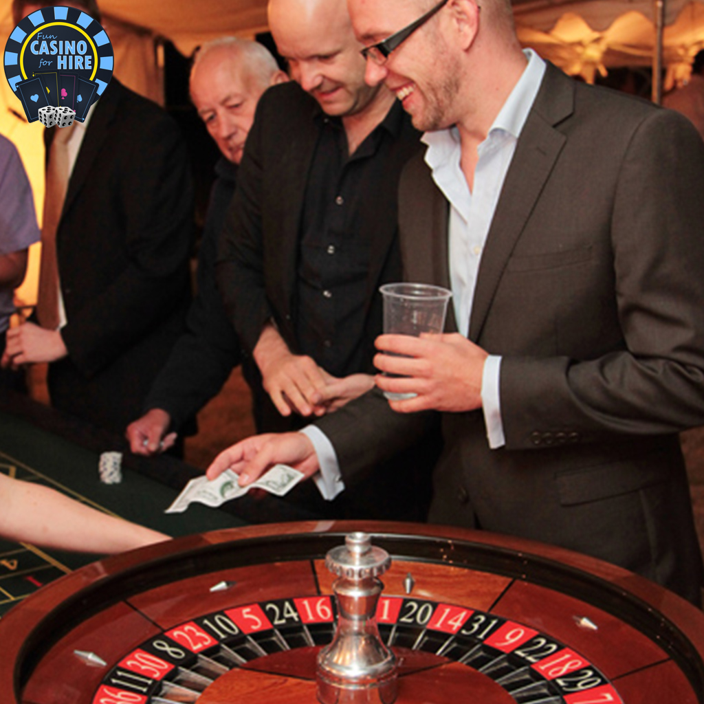 Men playing roulette at a wedding