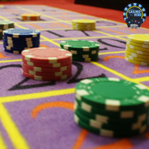 fun casino hire roulette chips on table